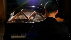 4K Dolly Shot of Male Piano Solo Playing Beautifully on Stage with Grand Piano - stock footage