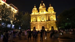 People in the evening at the Cathedral of St. Joseph, Beijing Stock Footage