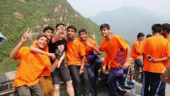 Tourists visiting the Great Wall of China are doing self Stock Footage