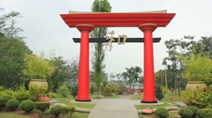 Japanese garden with red tori gate Stock Footage
