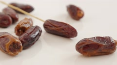Date palm fruit exotic dried fruit on white background slow tilting  4K 2160p Stock Footage