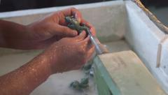 Carver of stone makes the machine jade figurine in traditional oriental style Stock Footage