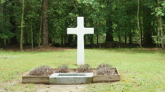 3898 White Stone Cross in Forest Next to Tombstone, 4K Stock Footage