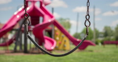 Empty swing at playground swaying in the wind 4k Stock Footage