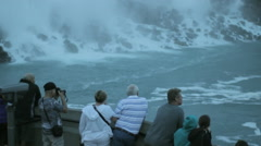 Tourists look out over the falls Stock Footage
