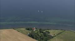 AERIAL Denmark-Klintholm Havn To Lighthouse At Mons Klint Stock Footage