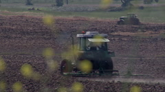 Tractor plowing the land 3 Stock Footage