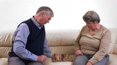 Senior activity, grandparents playing chess, active old people  - stock footage