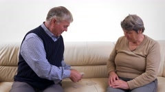 Couple of seniors playing cards together, acitve old persons Stock Footage