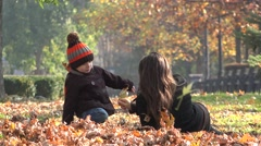 Stock Video Footage of Beautiful autumn scenery, mother and son enjoying nature