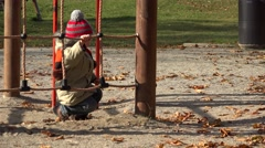 Funny child playing at playground, amusing boy overcome obstacle, smiling  - stock footage