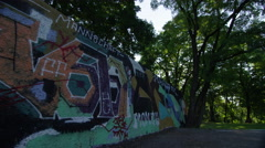 Graffitti Wall in Park - 4k Stock Footage