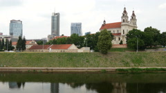 Time lapse from the Neris River and St Raphael The Archangel Church in Vilnius Stock Footage
