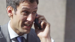 4k, successful businessman on cell phone outside office building Stock Footage