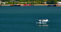 4K Seaplane Lands on Vancouver, Burrard Inlet, Coal Harbour, Canada Stock Footage