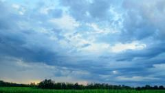 Impressive summer landscape over fields and dark blue sky. Time lapse. Stock Footage