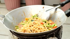 spaghetti stir fried in frying pan - stock footage