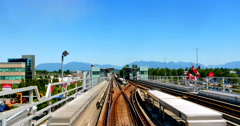 4K Skytrain Rolls up and Stops at Train Station Stock Footage
