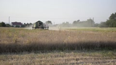 Harvester Working in Field Stock Footage