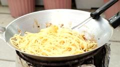 spaghetti stir fried in frying pan - stock footage