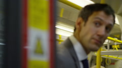 4k, City businessman with suitcase gets off underground train Stock Footage