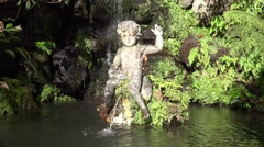 4k Pond with spring and putto figure tropical garden closeup Stock Footage