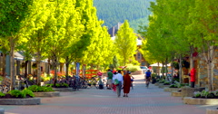 4K Spring Time Trees in Whistler Village, Early Morning Shopping Stock Footage