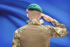 Soldier saluting to Canadial province flag series - Alberta Stock Photos