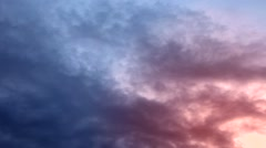 Cumulus clouds high in the sky at sunset. Stock Footage
