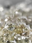 Many valuable diamonds raw and cut for further processing for the jewelery Stock Photos