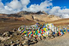 Buddhist prayer flags (lungta) on Baralacha La pass in Himalayas Stock Photos