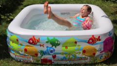 Small girl playing in the inflatable pool, summer time Stock Footage