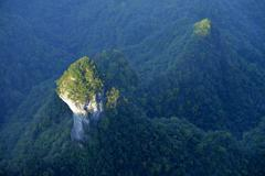 Mushroom shaped rock surrounded by a forest Tianmen National Park Hunan - stock photo
