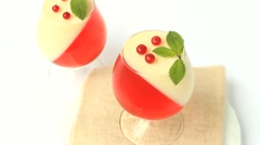 Jelly dessert with berries in a glass Stock Footage