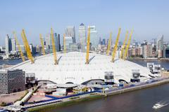 Stock Photo of The Dome Millennium Dome The O2 with Canary Wharf financial district on the