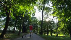 Park Path Morning Runners Sun Trees - 4k Stock Footage