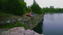 Extreme Sport Cliff Jumping into Beautiful Lake - Young Athlete - stock footage