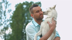 Man and his dog in the park, husky dog Stock Footage