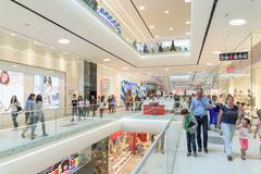 People Crowd Rush In Shopping Luxury Mall - stock photo