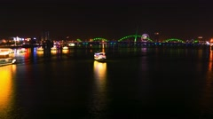 Da Nang: Night city view with Dragon Bridge, glowing lotus and boats. Stock Footage