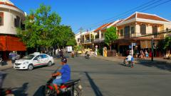 Hoi An ancient city junction street view with people and traffic. 4K Stock Footage