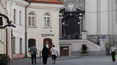 Nun walking in the street of old town Vilnius Lithuania Stock Footage