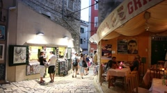 Tourists walking on street in Rovinj - stock footage