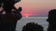 Tourists watching sunset at sea Stock Footage