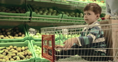 Boy in Shopping Cart - stock footage