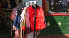 Chinatown Store - Sidewalk Vitrine - Passing People Stock Footage
