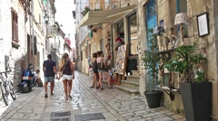 Tourists wathing souvenirs in street of Rovinj Stock Footage