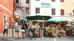 Tourists walking on market in Rovinj - stock footage