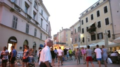 Tourists walking on promenade in Rovinj Stock Footage