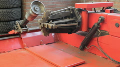 Truck tire change machine demonstration Stock Footage